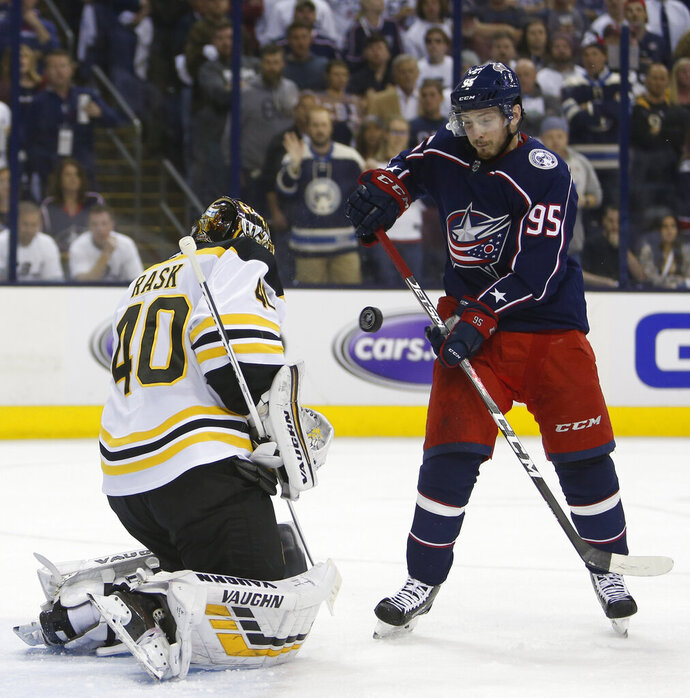 Boston Bruins' Tuukka Rask, left, of Finland, makes a save against Columbus Blue Jackets' Matt Duchene during the second period of Game 6 of an NHL hockey second-round playoff series Monday, May 6, 2019, in Columbus, Ohio. (AP Photo/Jay LaPrete)