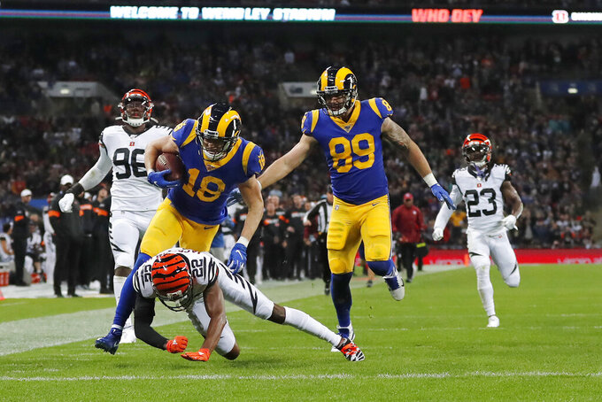 Los Angeles Rams wide receiver Cooper Kupp (18) runs toward the end zone to score against Cincinnati Bengals cornerback William Jackson (22) during the first half of an NFL football game, Sunday, Oct. 27, 2019, at Wembley Stadium in London. (AP Photo/Frank Augstein)