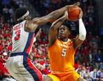 Tennessee guard Admiral Schofield (5) is jammed up by Mississippi guard Terence Davis (3) during the first half of an NCAA college basketball game in Oxford, Miss., Wednesday, Feb. 27, 2019. (AP Photo/Rogelio V. Solis)