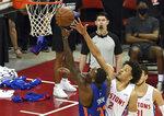 New York Knicks forward Aamir Simms (32) shoots against Detroit Pistons guard Cade Cunningham (2) during the first half of an NBA summer league basketball game Friday, Aug. 13, 2021, in Las Vegas. (AP Photo/David Becker)