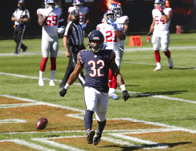 Chicago Bears running back David Montgomery (32) celebrates after rushing for a touchdown in the first quarter of an NFL football game against the New York Giants, Sunday, Sept. 20, 2020, in Chicago. (John J. Kim/Chicago Tribune via AP)