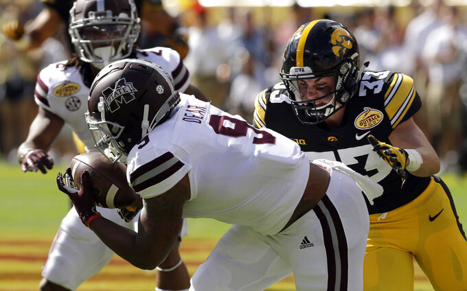Mississippi State wide receiver Malik Dear (9) gets hit by Iowa defensive back Riley Moss (33) after a reception in the first half of the Outback Bowl NCAA college football game, Tuesday, Jan. 1, 2019, in Tampa, Fla. (AP Photo/Chris O'Meara)