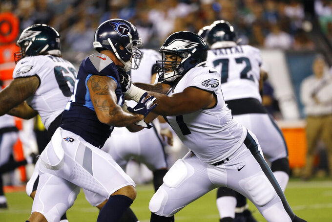 Philadelphia Eagles' Andre Dillard, right, works against Tennessee Titans' Kamalei Correa during the first half of a preseason NFL football game Thursday, Aug. 8, 2019, in Philadelphia. (AP Photo/Michael Perez)