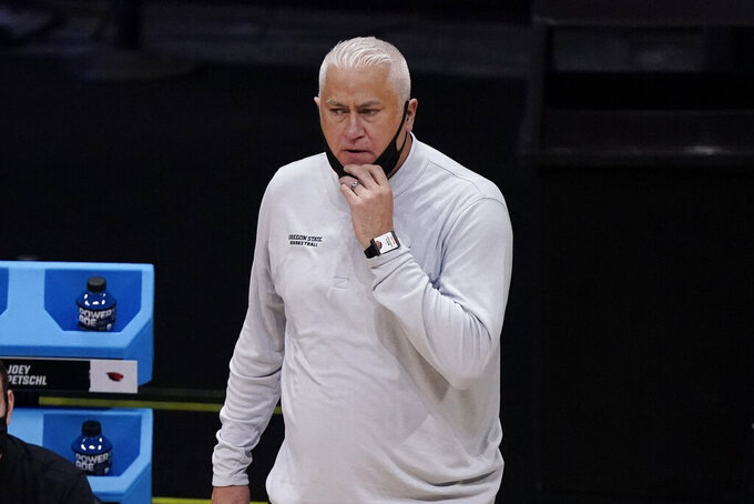 Oregon State head coach Wayne Tinkle watches against Houston during the first half of an Elite 8 game in the NCAA men's college basketball tournament at Lucas Oil Stadium, Monday, March 29, 2021, in Indianapolis. (AP Photo/Michael Conroy)