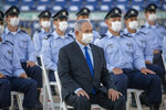 Israeli Prime Minister Benjamin Netanyahu wearing a face mask attends a graduation ceremony for new pilots in Hatzerim air force base near the southern Israeli city of Beersheba, Israel, Thursday, June 25, 2020. (AP Photo/Ariel Schalit, Pool)