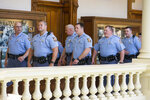 Georgia State Troopers walk toward the Senate chambers gallery during the 35th legislative day at the Georgia State Capitol building in downtown Atlanta, Friday, March 22, 2019. The Georgia Senate is set for a lengthy debate on the anti-abortion