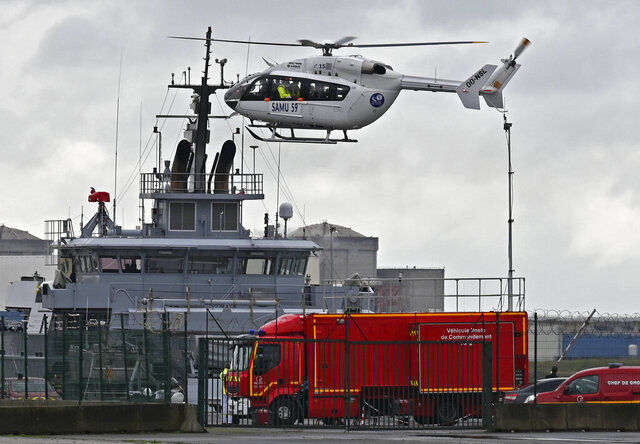 A French rescue helicopter lands close to a rescue vessel in Dunkirk, northern France, Tuesday, Oct. 27, 2020 during a  search operation after four migrants, including a 5-year-old and 8-year-old child died Tuesday when their boat capsized while they and other migrants tried to cross the English Channel to Britain, French authorities said. Fifteen migrants have been saved so far and rescue and search operations are still under way, according to the regional administration for the Nord region. (AP Photo)
