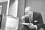 FILE - In this Nov. 22, 1962, file photo, sports announcer and founder of the American Football League Harry Wismer eats a Thanksgiving snack in his New York hotel room, while watching his team, the New York Titans, edge the Denver Broncos, 46-45 on television. (AP Photo/Marty Lederhandler, File)