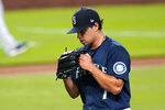 Seattle Mariners starting pitcher Marco Gonzales pounds his glove as he heads off the field in the sixth inning of a baseball game against the Houston Astros, Monday, Sept. 21, 2020, in Seattle. (AP Photo/Elaine Thompson)