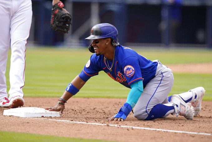New York Mets' Francisco Lindor slides safely back to first base during the fourth inning of a spring training baseball game against the Washington Nationals, Monday, March 8, 2021, in West Palm Beach, Fla. (AP Photo/Lynne Sladky)