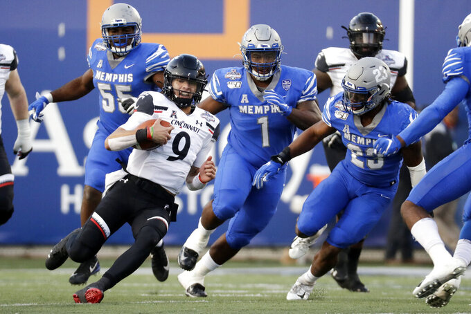 Cincinnati quarterback Desmond Ridder (9) scrambles against Memphis during the first half of an NCAA college football game for the American Athletic Conference championship Saturday, Dec. 7, 2019, in Memphis, Tenn. (AP Photo/Mark Humphrey)