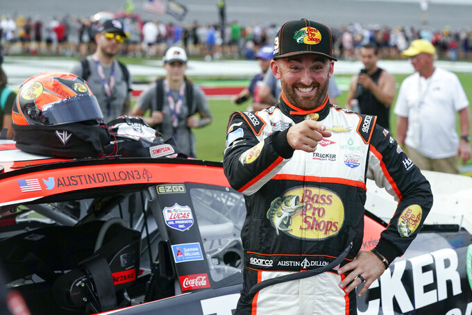 Austin Dillon jokes with family and friends on pit road before the NASCAR Cup Series auto race at Daytona International Speedway, Saturday, Aug. 28, 2021, in Daytona Beach, Fla. (AP Photo/John Raoux)