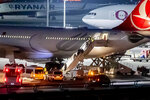 In this , Tursday, Nov. 14, 2019 photo people leave an airplaine of the airline 'Turkish Airline' at the airport Tegel in Berlin, Germany. German federal police say they have detained seven people deported by Turkey for Islamic State links. Federal police detained them as they arrived Thursday afternoon at Berlin's Tegel airport. (Christoph Soeder/dpa via AP)