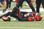 Cincinnati Bengals wide receiver Tee Higgins (85) grabs his leg after making a catch during the first half of an NFL football game against the Baltimore Ravens, Sunday, Jan. 3, 2021, in Cincinnati. (AP Photo/Aaron Doster)
