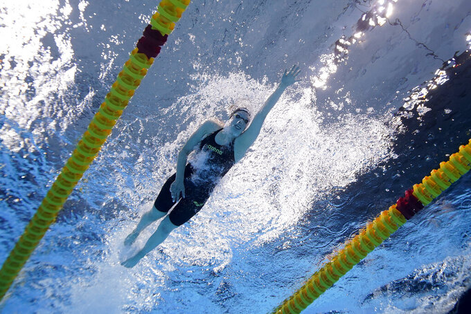 Germany's Celine Rieder swims in a 1,500-meter freestyle heat at the 2020 Summer Olympics, Monday, July 26, 2021, in Tokyo. (AP Photo/David J. Phillip)