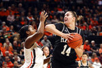 Hawaii's Lauren Rewers (14) tries to get past Oregon State's Madison Washington (3) during the first half of an NCAA college basketball game in Corvallis, Ore., Friday, Dec. 6, 2019. (AP Photo/Amanda Loman)