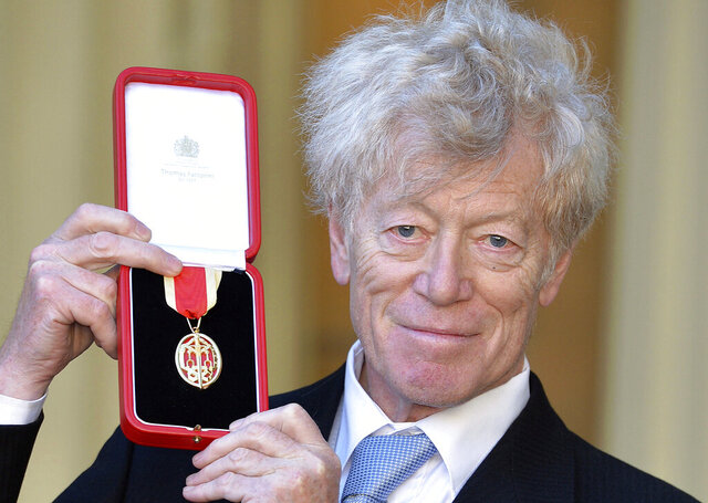 FILE  - In this Nov. 25, 2016 file photo, philosopher Roger Scruton poses with his award after being knighted for services to philosophy, teaching and public education, in London. Scruton, one of Britain's most prominent conservative thinkers, has died aged 75. Scruton's family said in a statement that he died Sunday, Jan. 12, 2020 after a six-month battle with cancer. (John Stillwell/PA via AP, File)