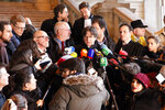 Catalonia's former regional president Carles Puigdemont speaks with journalists as he leaves the Justice Palace in Brussels, Monday, Dec.16, 2019. (AP Photo/Francois Walschaerts)