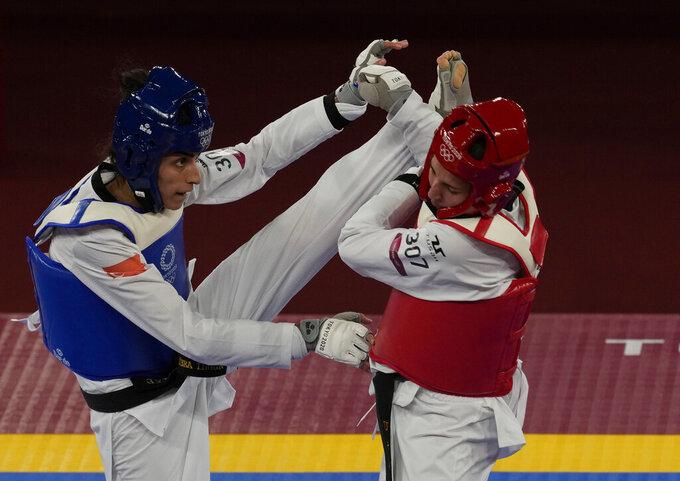 Turkey's Hatice Kübra İlgün, left, attacks United States's Anastasija Zolotic during the taekwondo women's 57kg match at the 2020 Summer Olympics, Sunday, July 25, 2021, in Tokyo, Japan. (AP Photo/Themba Hadebe)