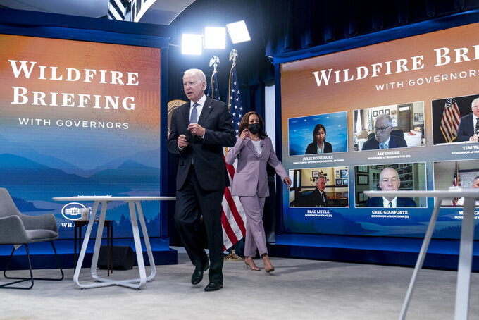 President Joe Biden and Vice President Kamala Harris arrive for a meeting with governors to discuss ongoing efforts to strengthen wildfire prevention, preparedness and response efforts, and hear firsthand about the ongoing impacts of the 2021 wildfire season in the South Court Auditorium in the Eisenhower Executive Office Building on the White House Campus in Washington, Friday, July 30, 2021. (AP Photo/Andrew Harnik)