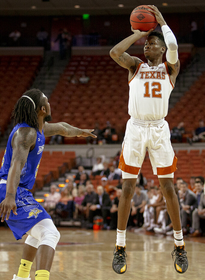 Texas guard Kerwin Roach II (12) shoots over South Dakota State guard David Jenkins (5) during a first round game of the NCAA college basketball National Invitation Tournament in Austin, Texas, Tuesday, March 19, 2019. (Nick Wagner/Austin American-Statesman via AP)
