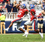 Mississippi defensive back Myles Hartsfield (15) intercepts a pass and celebrates with Mississippi defensive back Jalen Julius (26) against Southeast Louisiana during the first half of an NCAA college football game, Saturday, Sept. 14, 2019 in Oxford, Miss. (Bruce Newman/The Oxford Eagle via AP)