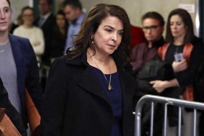 Actress Annabella Sciorra returns after a lunch break in Harvey Weinstein's rape trial, Thursday, Jan. 23, 2020, in New York. (AP Photo/Richard Drew)