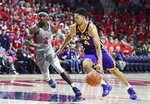 FILE - In this Jan. 15, 2019, file photo, LSU guard Skylar Mays (4) drives past Mississippi guard Terence Davis (3) during the first half of an NCAA college basketball game in Oxford, Miss. Mays and the 23rd-ranked LSU Tigers are hoping for a lot less off-the-court drama this season. They also hope that what they went through last year--from the preseason shooting death of teammate Wayde Sims to the late-season suspension of coach Will Wade--has instilled in them a resilience that will serve them well going forward. (AP Photo/Thomas Graning, File)