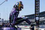 Romain Grosjean, of Switzerland, climbs out of his car following practice for the IndyCar auto race at Indianapolis Motor Speedway, Friday, May 14, 2021, in Indianapolis. (AP Photo/Darron Cummings)