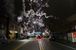 Fireworks explode in the sky during a protest in response to the police shooting of Walter Wallace Jr., early Tuesday, Oct. 27, 2020, in Philadelphia. Police officers fatally shot the 27-year-old Black man during a confrontation Monday afternoon in West Philadelphia that quickly raised tensions in the neighborhood. (Jessica Griffin/The Philadelphia Inquirer via AP)