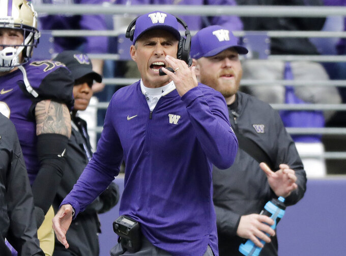 Washington head coach Chris Petersen calls to his team during the first half of an NCAA college football game against Colorado, Saturday, Oct. 20, 2018, in Seattle. (AP Photo/Ted S. Warren)