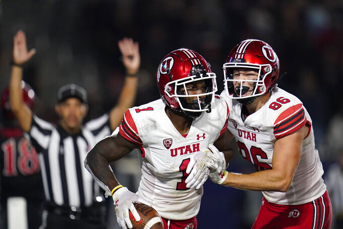 Utah wide receiver Theo Howard (1) celebrates with Utah tight end Dalton Kincaid (86) after scoring a touchdown during the second half of an NCAA college football game against Utah Saturday, Sept. 18, 2021, in Carson, Calif. (AP Photo/Ashley Landis)