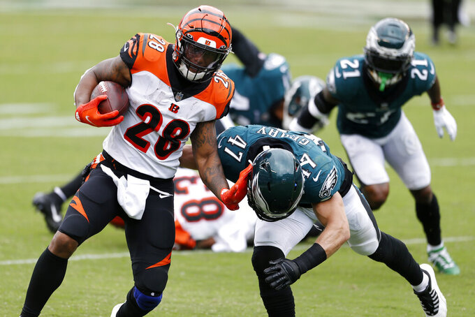 Cincinnati Bengals' Joe Mixon (28) tries to run past Philadelphia Eagles' Nathan Gerry (47) during the second half of an NFL football game, Sunday, Sept. 27, 2020, in Philadelphia. (AP Photo/Laurence Kesterson)