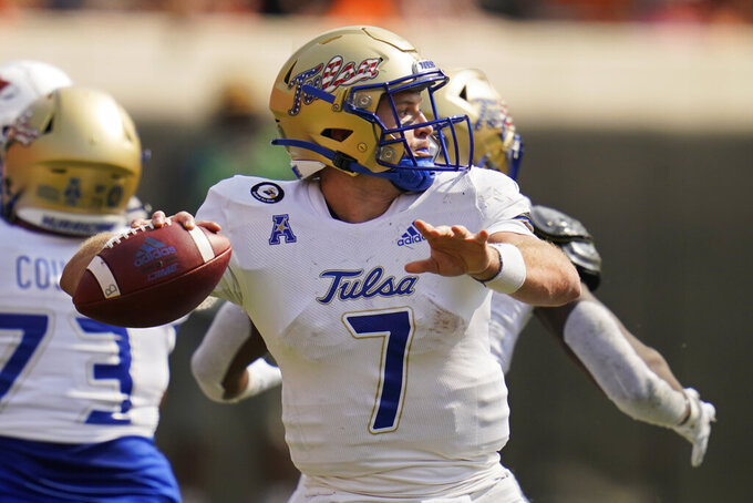 Tulsa quarterback Davis Brin (7) throws in the first half of an NCAA college football game against Tulsa, Saturday, Sept. 11, 2021, in Stillwater, Okla. (AP Photo/Sue Ogrocki)
