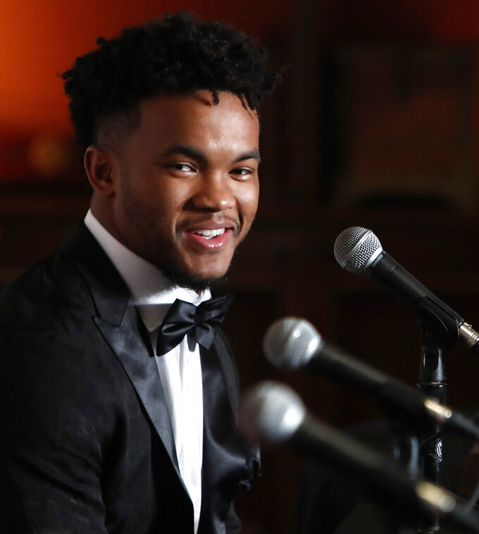 Heisman Trophy winner quarterback Kyler Murray smiles during the Davey O'Brien Award news conference in Fort Worth, Texas, Monday, Feb. 18, 2019. Murray accepted the award in his first public appearance since he announced his plan to pursue an NFL football career rather than report to spring training as a first-round pick of the Oakland A's. (AP Photo/LM Otero)