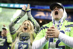 Seattle Seahawks fans celebrate a win during an NFL game against the Los Angeles Rams, Thursday, Oct. 3, 2019, in Seattle. The Seahawks defeated the Rams 30-29. (Margaret Bowles via AP)