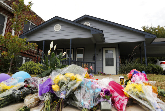 In this Oct. 15, 2019, photo, a makeshift memorial rests on the sidewalk that leads to the home of Atatiana Jefferson in Fort Worth, Texas. Former Fort Worth Police officer Aaron Dean shot Jefferson, through a back window around 2:30 a.m. after a neighbor reported her front door was left open. (AP Photo/Tony Gutierrez)