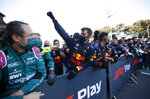 A member of the Red Bull crew cheers as Red Bull driver Sergio Perez of Mexico crosses the finish line to win the Formula One Grand Prix at the Baku Formula One city circuit in Baku, Azerbaijan, Sunday, June 6, 2021. (Maxim Shemetov, Pool via AP)