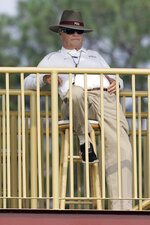 FILE - In this Aug. 7, 2007, file photo, Florida State head coach Bobby Bowden watches the first day of CAA college football practice from his tower in Tallahassee, Fla. Bowden, the folksy Hall of Fame coach who built Florida State into an unprecedented college football dynasty, has died. He was 91. Bobby's son, Terry, confirmed to The Associated Press that his father died at home in Tallahassee, Fla., surrounded by family early Sunday, Aug. 8, 2021. (AP Photo/Phil Coale, File)
