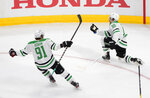 Dallas Stars center Joe Pavelski (16) celebrates his goal against the Tampa Bay Lightning with teammate Tyler Seguin (91) during the third period of Game 5 of the NHL hockey Stanley Cup Final, Saturday, Sept. 26, 2020, in Edmonton, Alberta. (Jason Franson/The Canadian Press via AP)