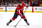 Washington Capitals defenseman John Carlson (74) shoots the puck during the second period of an NHL hockey game against the Carolina Hurricanes, on Monday, Jan. 13, 2020, in Washington. (AP Photo/Al Drago)