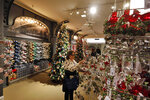 In this Tuesday, Nov. 5, 2019, photo shoppers browse the Holiday Lane section at the Macy's flagship store, in New York. With three weeks until the official start of the holiday shopping season, the nation's retailers are gearing up for what will be another competitive shopping period. (AP Photo/Richard Drew)