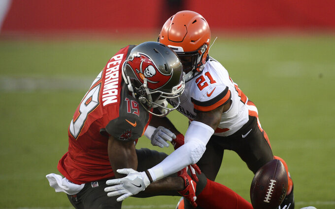 Cleveland Browns cornerback Denzel Ward (21) knocks the ball away from Tampa Bay Buccaneers wide receiver Breshad Perriman (19) during the first half of an NFL preseason football game Friday, Aug. 23, 2019, in Tampa, Fla. (AP Photo/Jason Behnken)