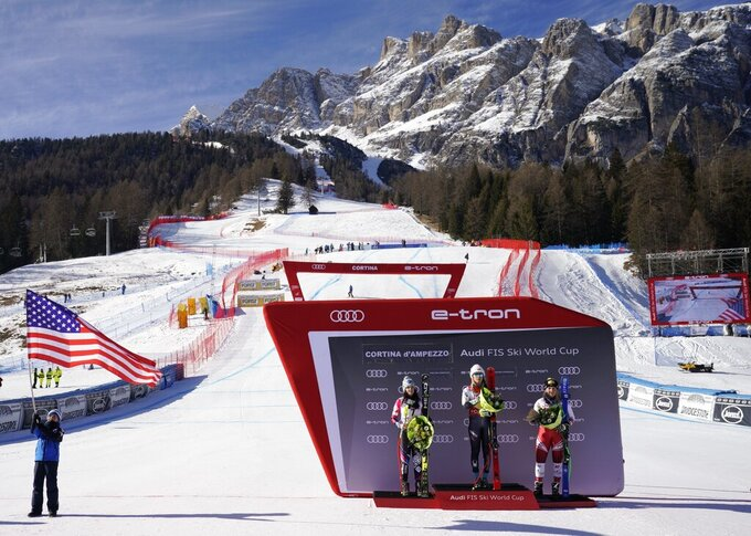 FILE - In this Sunday, Jan. 20, 2019 file photo, United States' Mikaela Shiffrin, center, winner of an alpine ski, women's World Cup super-G, poses on the podium with second placed Liechtenstein's Tina Weirather, left, and third placed Austria's Tamara Tippler, in Cortina D'Ampezzo, Italy. The natural beauty of Cortina will be of special importance at the alpine ski World championships, with organizers hoping that the images from the slopes beamed around the globe to TV viewers will make up for the lack of fans amid the coronavirus pandemic. (AP Photo/Giovanni Auletta, File)