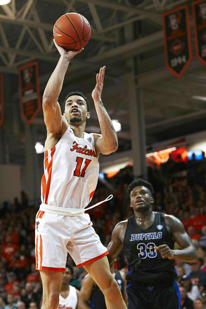 Bowling Green guard Antwon Lillard (11) shoots against Buffalo forward Nick Perkins (33) in the second half of an NCAA college basketball game in Bowling Green, Ohio, Friday, Feb. 1, 2019. (AP Photo/Rick Osentoski)