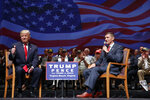 "FILE - Then-presidential candidate Donald Trump gives a thumbs up as he speaks with retired Lt. Gen. Michael Flynn during a town hall, Tuesday, Sept. 6, 2016, in Virginia Beach, Va. President Donald Trump has pardoned Michael Flynn, taking direct aim in the final days of his administration at a Russia investigation that he has long insisted was motivated by political bias. Trump announced the pardon on Wednesday, Nov. 25, 2020 calling it his ""Great Honor."" (AP Photo/Evan Vucci, file)"