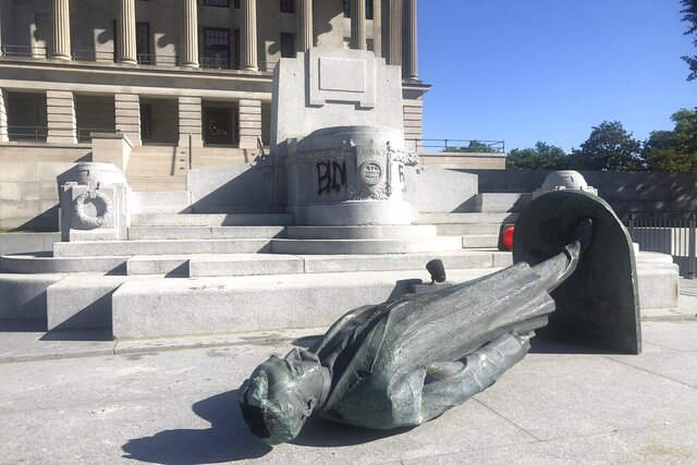 Protesters toppled the statue of Edward Carmack outside the state Capitol after a peaceful demonstration turned violent, Sunday, May 31, 2020, in Nashville, Tenn. (AP Photo/Kimberlee Kruesi)