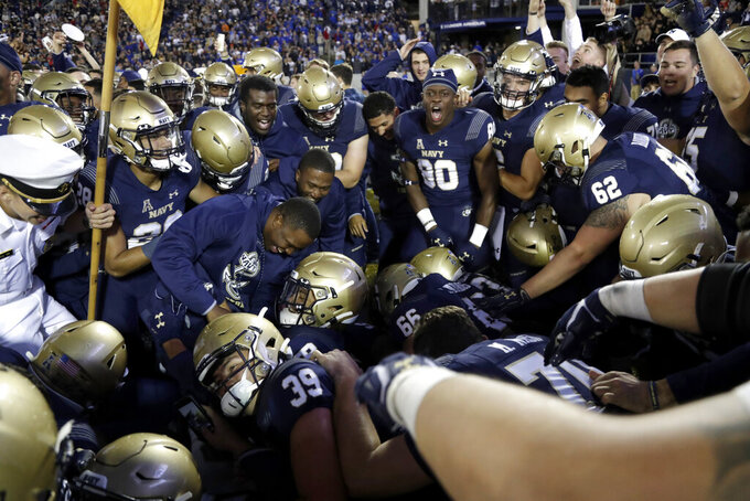 Navy players gather after defeating Air Force 34-25 during an NCAA college football game Saturday, Oct. 5, 2019, in Annapolis, Md. (AP Photo/Julio Cortez)