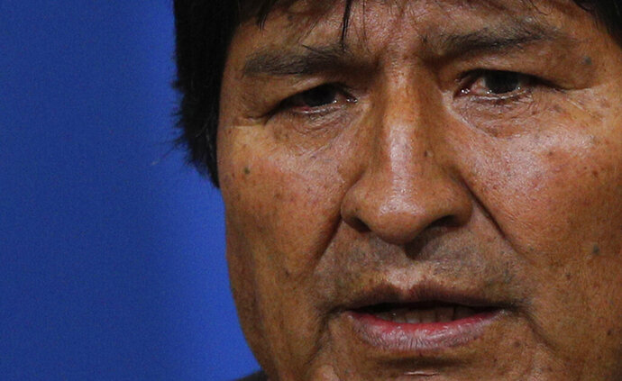 Bolivia's President Evo Morales speaks during a press conference at the military base in El Alto, in the outskirts of La Paz, Bolivia, Nov. 10, 2019. Hours later Morales announced his resignation under mounting pressure from the military and the public after his re-election victory triggered weeks of fraud allegations and deadly protests. (AP Photo/Juan Karita)