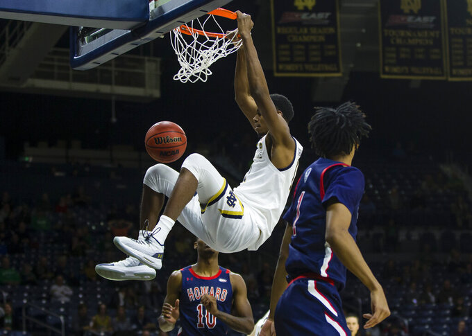 Notre Dame's Juwan Durham (11) dunks during an NCAA college basketball game against Howard Tuesday, Nov. 12, 2019 at Purcell Pavilion in South Bend, Ind. (Michael Caterina/South Bend Tribune via AP)
